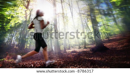 Girl Running in forest - stock photo