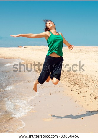 girl running on beach - stock photo