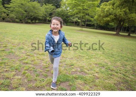 Girl running with a smile - stock photo