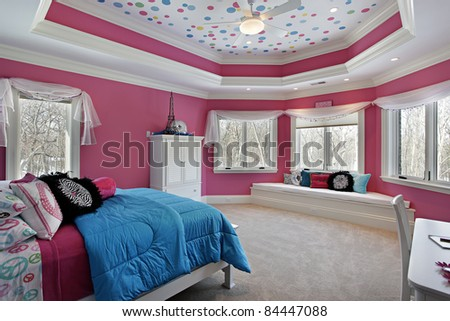 Girl's bedroom in luxury home with pink walls - stock photo