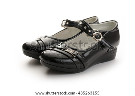 Girl's black classic shoes on white background