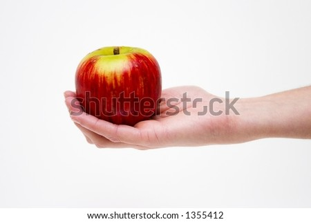 Girl's hand giving a red apple - stock photo