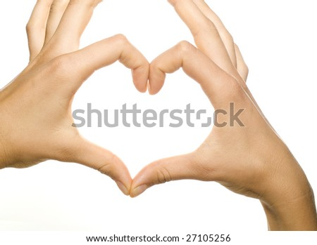 girl's hands forming a heart - stock photo