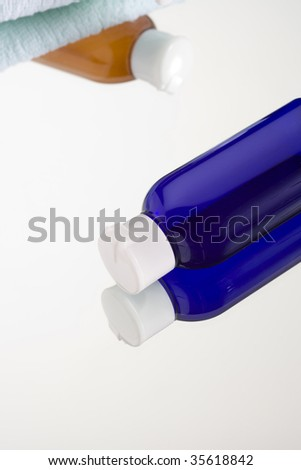 GIRL'S IMAGE- close-up shot of a blue bottle of facial lotion