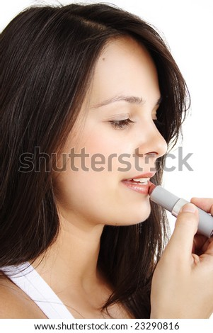 Girl's make-up with lipstick (Close-Up) - stock photo