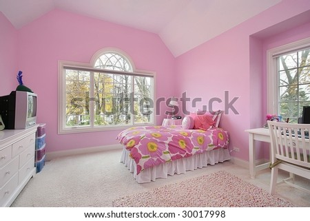 Girl's pink bedroom - stock photo