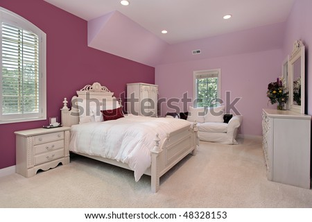 Girl's pink bedroom in luxury suburban home - stock photo