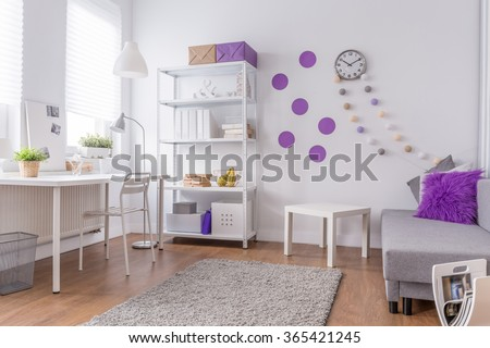 Girl's room - light and cozy purple interior - stock photo