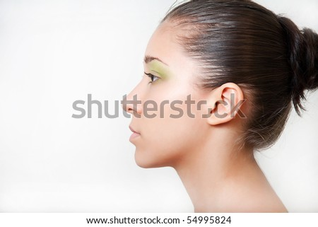 Girl's side view on white background
