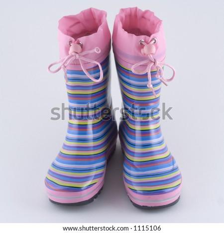 Girl's striped wellingtons - stock photo