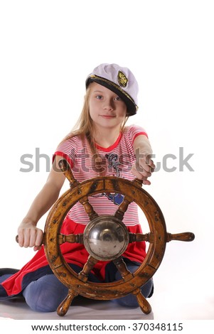 Girl sailor on a ship with a steering wheel in their hands - stock photo