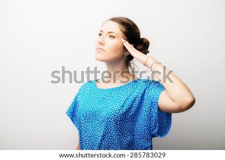 girl salutes - stock photo