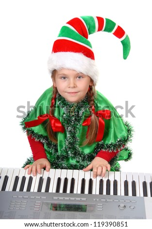 Girl - Santa's elf plays a synthesizer. Isolated on a white - stock photo