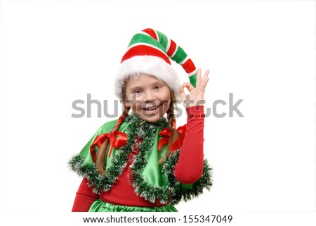Girl - Santa's elf showing sign OK. Isolated on the white background - stock photo
