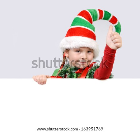 Girl - Santa's elf showing sign OK with the banner - stock photo