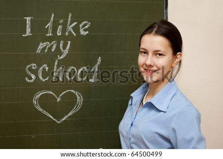 Girl schoolgirl meets an English lesson - stock photo