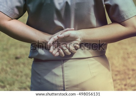Girl scout holding hands to rest of Line Regulation.Close-up of hands,Scout concept