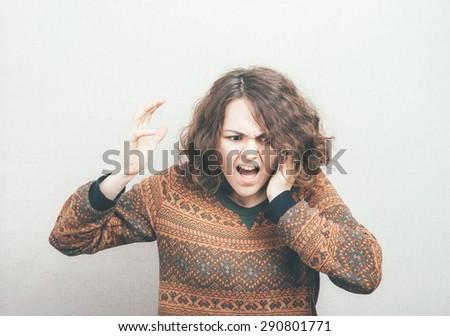 girl screaming in mobile phone - stock photo