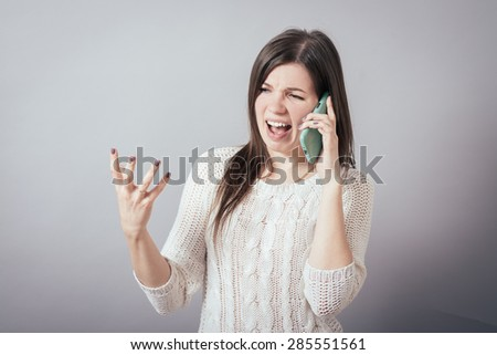 girl screaming on the phone - stock photo