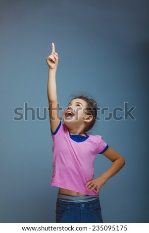 Girl screams raising his hand up - stock photo