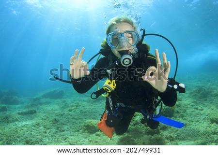 Girl Scuba Diver - stock photo