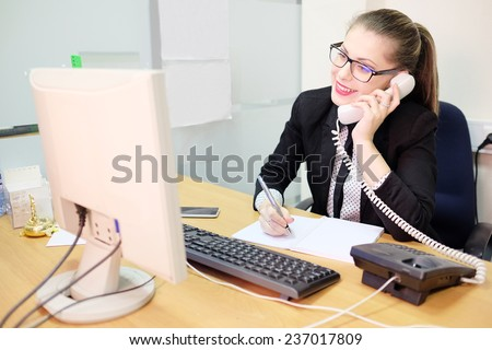 Girl secretary in an office - stock photo