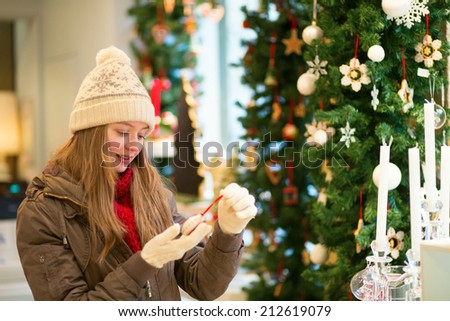 Girl selecting decoration on a traditional Christmas market - stock photo