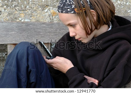 girl sending text - stock photo