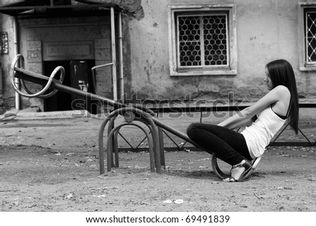 girl shakes on a swing - stock photo