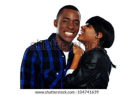 Girl sharing secrets with her boyfriend against white background - stock photo