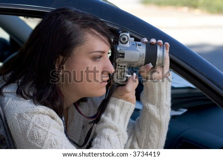 Girl shooting SLR photo camera