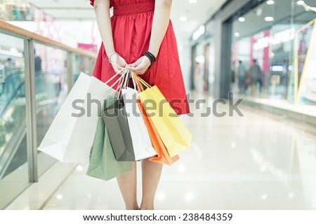 girl shopping at luxury mall in kowloon shanghai china - stock photo