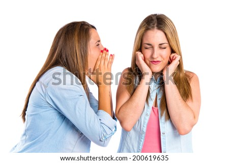 Girl shouting at her friend over white background  - stock photo