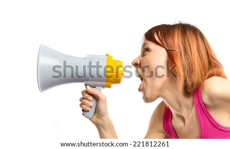Girl shouting by megaphone over white background - stock photo
