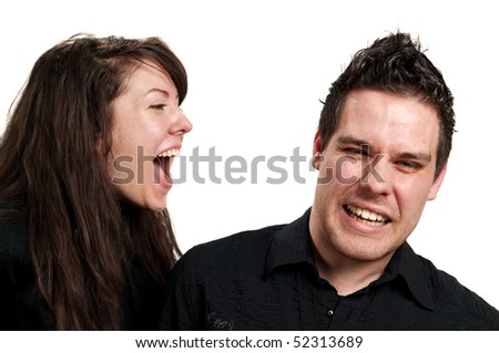 Girl shouting in guy's ear isolated on white background
