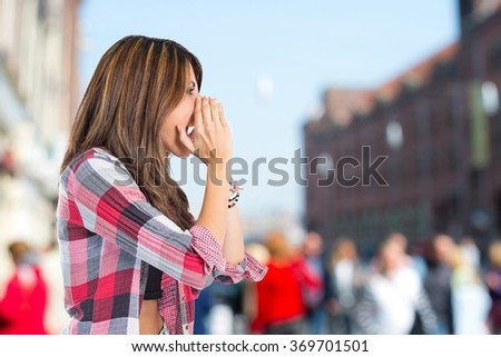 Girl shouting on unfocused background