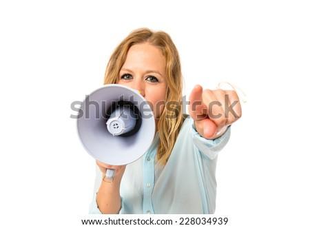 Girl shouting over isolated white background - stock photo