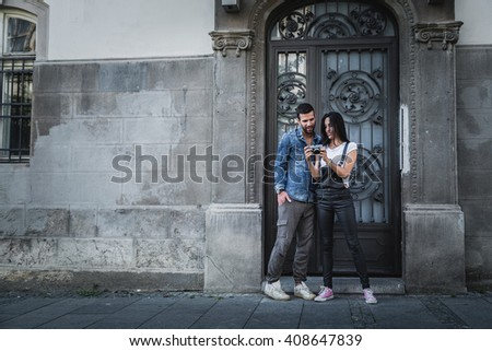 Girl showing camera to her boyfriend in the city