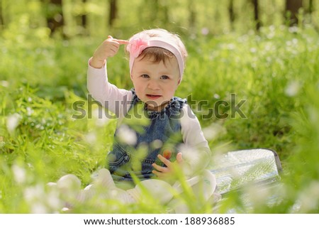 girl showing flower on her head ribbon - stock photo