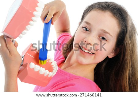 Girl showing right way to brushing teeth - stock photo