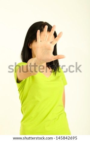 Girl showing stop sign isolated on white - stock photo