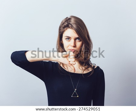 girl showing thumbs down - stock photo