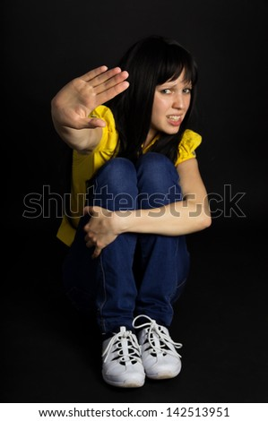 Girl shows a hand stop - stock photo