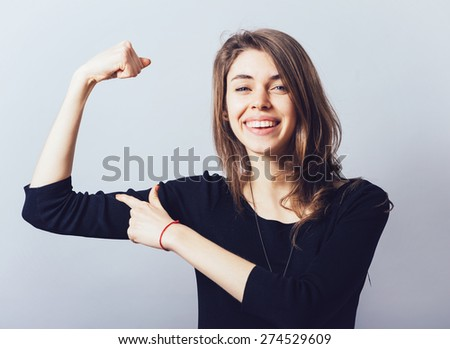 girl shows biceps - stock photo
