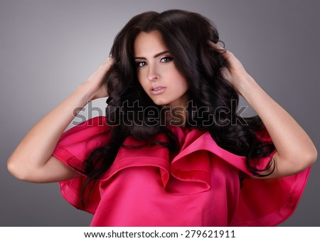 girl shows her beautiful hair. cheerful girl holding her beautiful hair curly. - stock photo