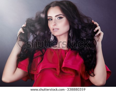 girl shows her beautiful hair. cheerful girl holding her beautiful hair curly - stock photo