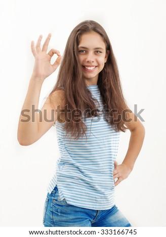 Girl shows ok - stock photo