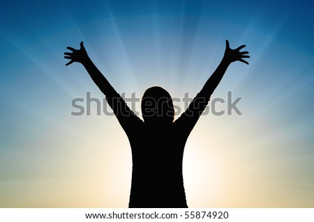 Girl silhouette on sky and sun rays background