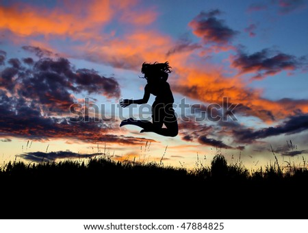 Girl silhouette over sunset background - stock photo