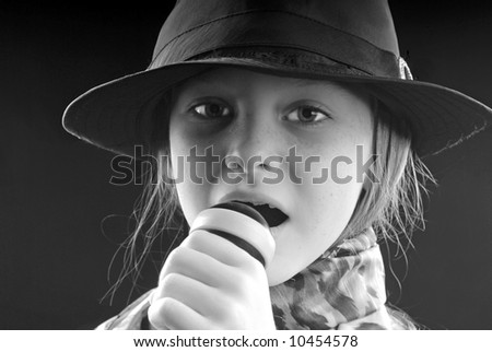 Girl Singing Into Microphone - stock photo